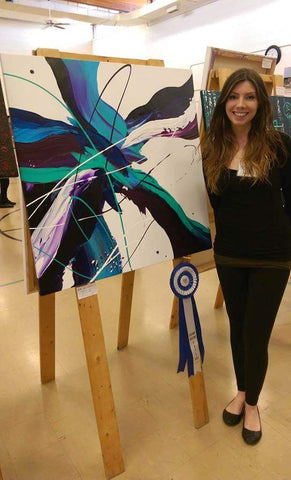 Nicole Nicholas with an award ribbon for her abstract painting
