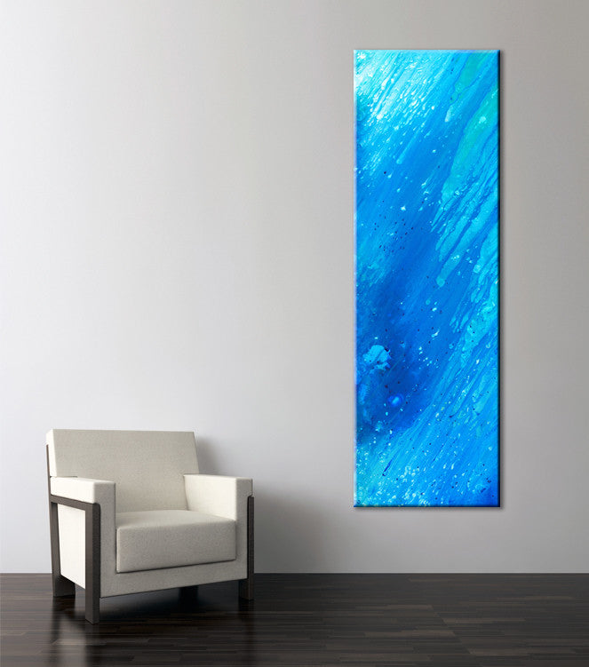Photo of a blue and turquoise abstract painting beside a chair