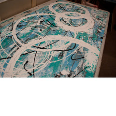 Close up image of a large, light blue and turquoise abstract, acrylic painting, featuring contemporary white circles.