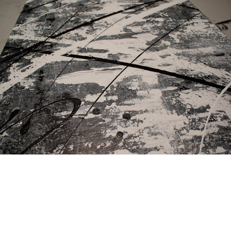 Close up image of a grey, white and black modern abstract painting with abstract art textures