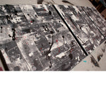 Canadian art galleries - close up image of a 3 panel grey, white and black modern abstract painting