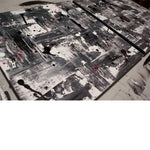 Close up image of a 3 panel grey, white and black modern painting art