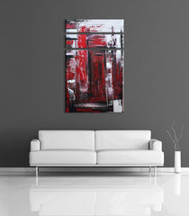 Abstract color art - Image of a 3 panel, red, black and white abstract acrylic painting on a grey wall, above a couch