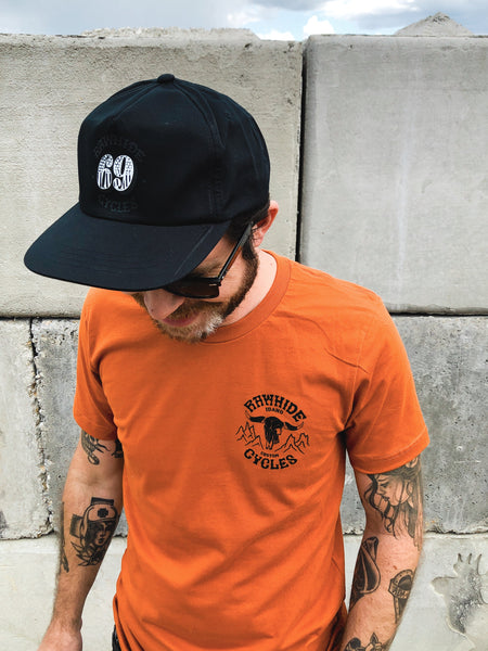 Rawhide Cycles x Matt Sabbath Cowskull Tee in Vintage Orange