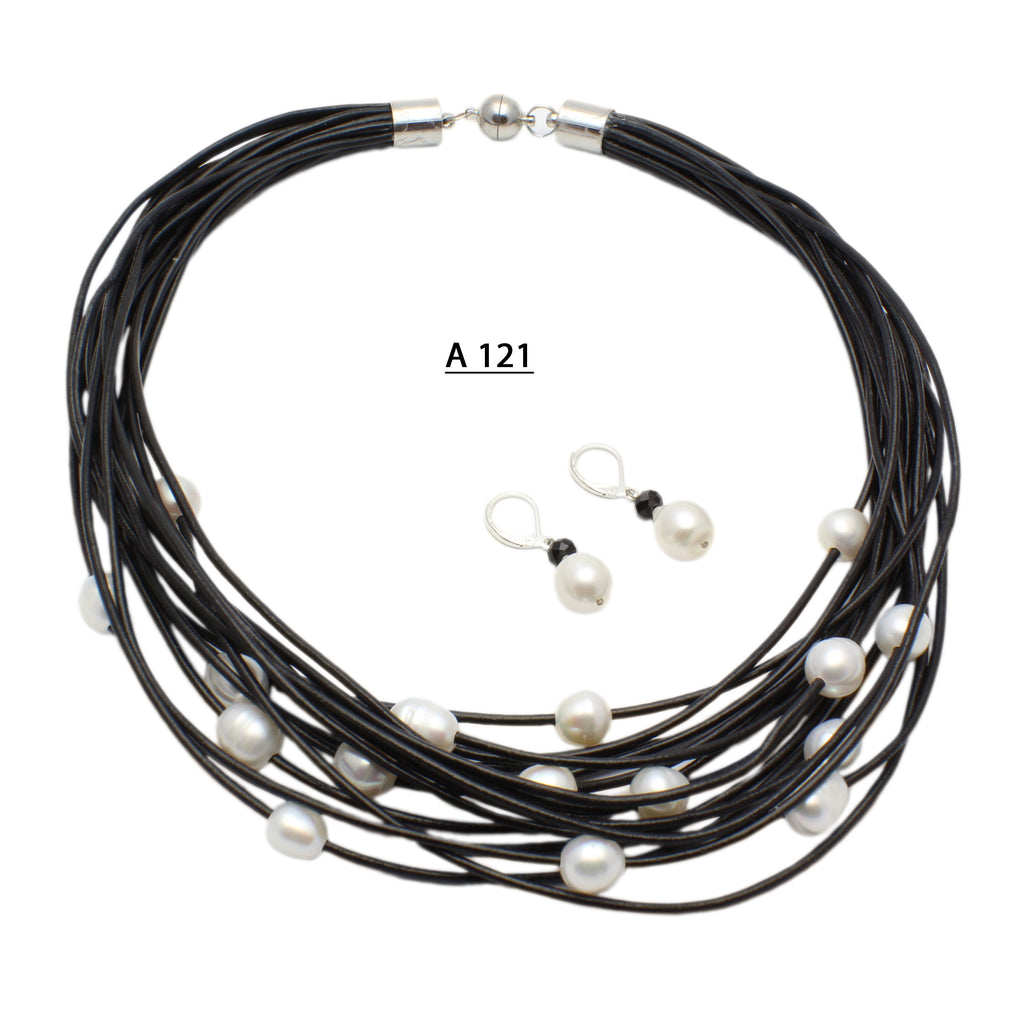 Sixteen Strands of Black Leather Cords with a 9-10 MM Freshwater Pearl on each strand.