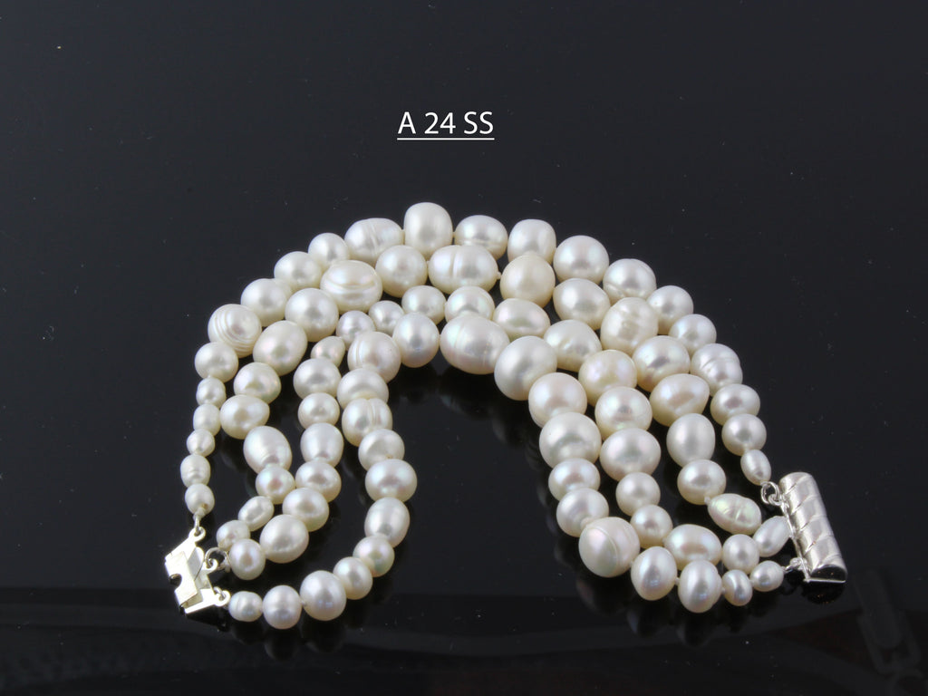 Four Strands of Natural Chunky Baroque and Round Freshwater Pearls Bracelets
