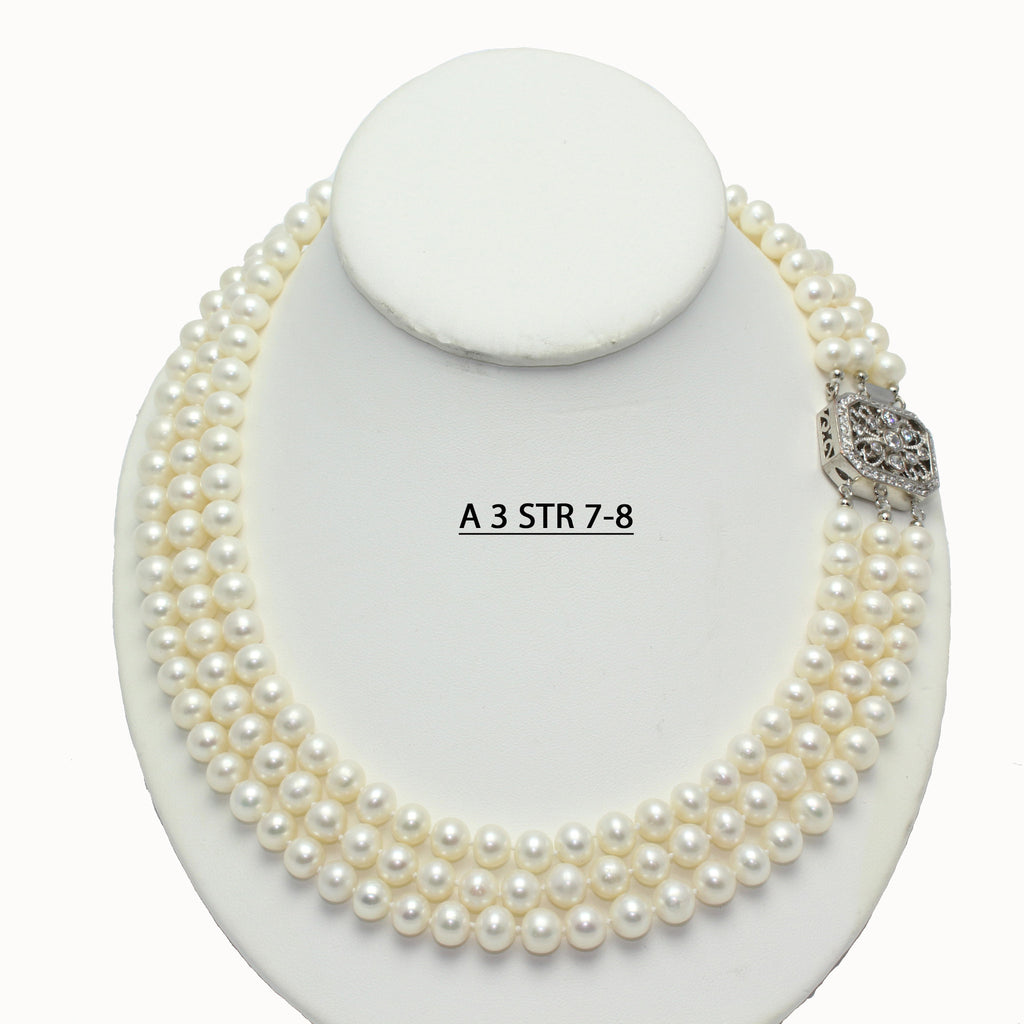 A 3 STR 7-8 Triple Strand AA+ White Cultured Freshwater Pearls Necklace with Vintage Style Clasp.