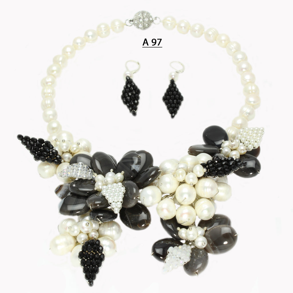 Three Flowers of a slightly Grey toned Black Onyx with crystal Leaves and freshwater Pearls necklace Set.