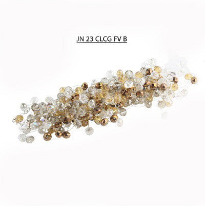 A mix of Sparkling Faceted Crystals in Copper, Clear AB, Smoke and Golden Colors Bracelet.