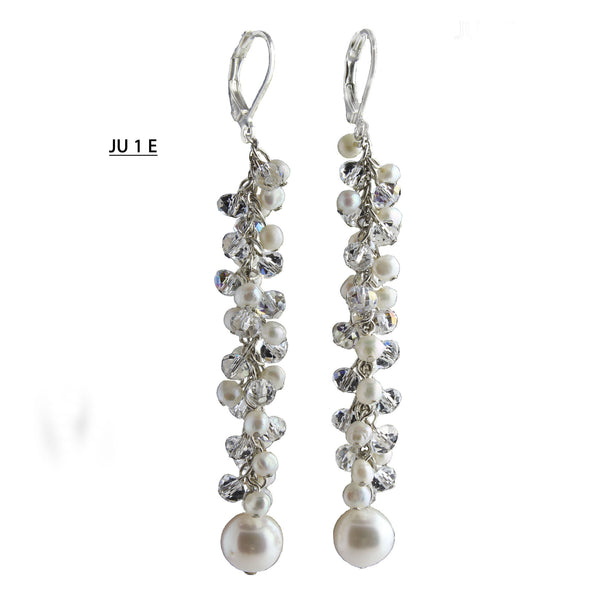 Tiny freshwater Pearls and Clear Crystals with a 9 MM FW Pearl at the end of the dangle earrings.
