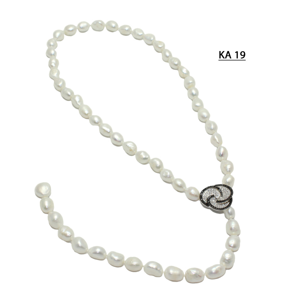Off Round White Freshwater Pearl necklace with adjustable clasp.