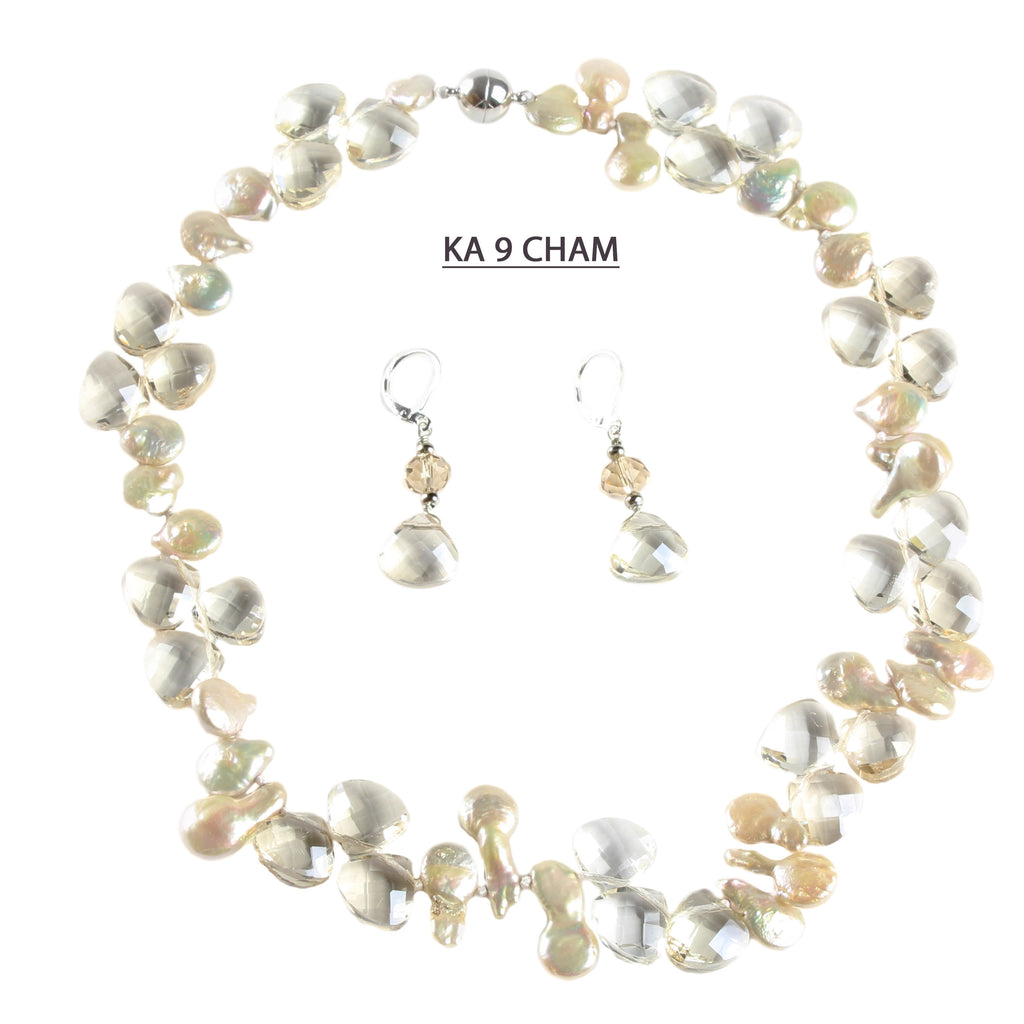 A Strand of Champagne Coin Pearls with Large Faceted Champagne Crystals and Matching Earrings.