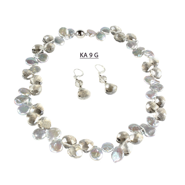 A Single Strand of Gray Coin Pearls with large faceted Smoke Crystals and matching earrings.