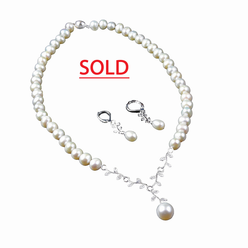 Single strand of 7.5 to 8.5 MM Freshwater Pearls with delicate Pave links to Teardrop shaped 11MM Pearl