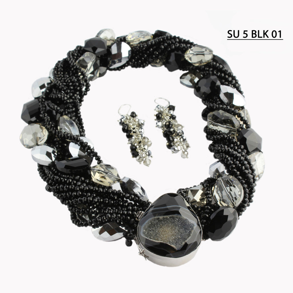 Multiple Strands of Faceted Black Crystals  with a mixed strand of Clear, Black and Smoke large faceted Crystals Statement Necklace Set.