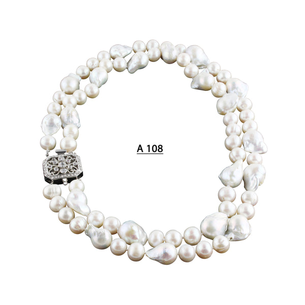A Double Strand White Baroque and Freshwater Pearls Necklace.
