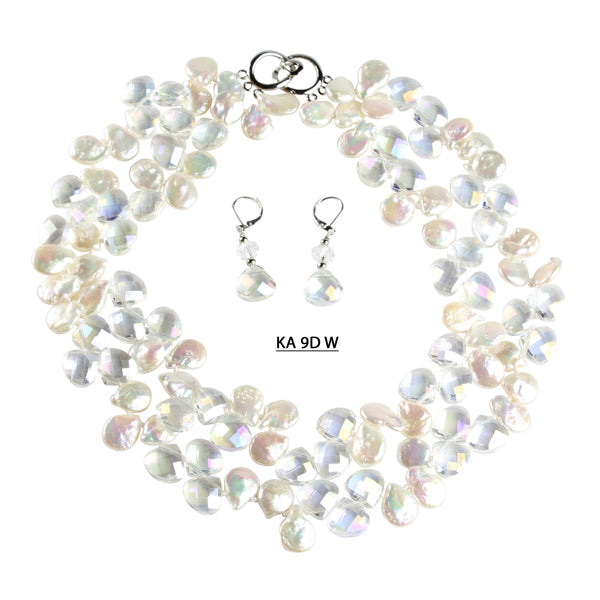 A Double Strand of 10-12 MM White Coin Pearls with Teardrop shaped faceted Clear AB crystals, with magnetic clasp and matching earrings.
