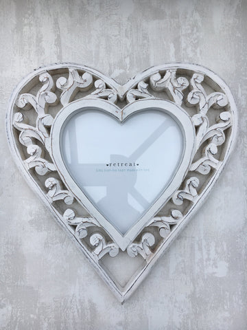 Filigree heart shaped picture frame