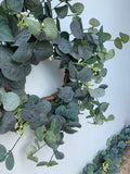 Eucalyptus and white flower table wreath