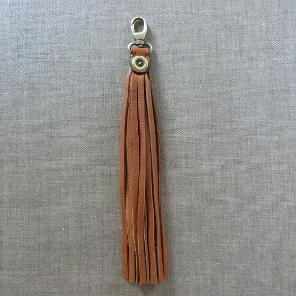 LEATHER TASSEL BAG CHARM - TAN