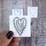 small heart temporary tattoo with plant element