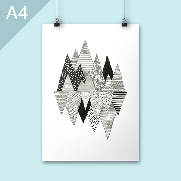 Graphic mountain illustration hung on wall