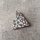 Mountain geometric pin on woollen jumper