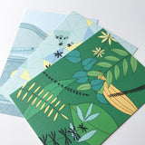 3 illustrated postcards on white background