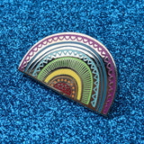 Shiny rainbow hard enamel pin on glitter background