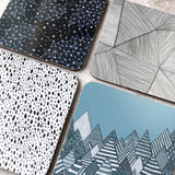 Close up of illustrated melamine coasters