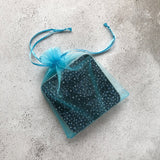 4 melamine coasters packed in blue organza bag