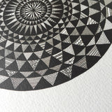 Detail of black and white mandala illustration print