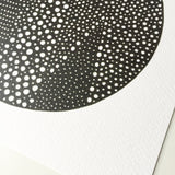 Detail of black and white spotty mountain illustration print