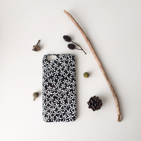 Black floral iPhone 6 case with twig and pinecones