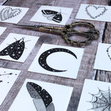 selection of different temporary tattoos displayed on wooden board