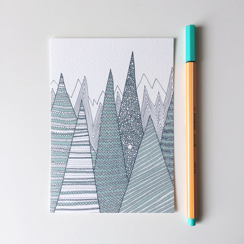 A6 postcard print of geometric teal mountains