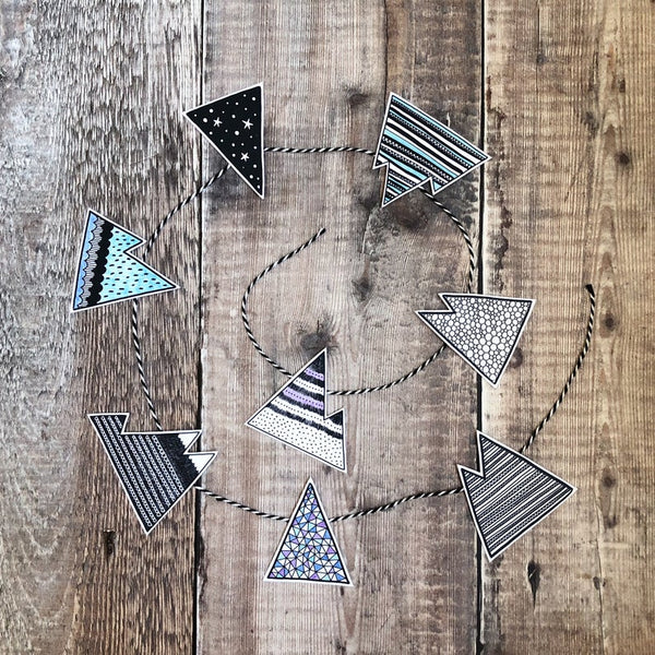 DIY paper mountain garland on wood background