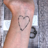 stars temporary heart tattoo shown on hand