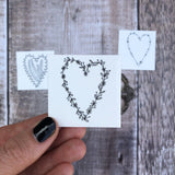 small floral wreath inspired temporary heart tattoo