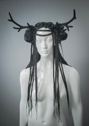 White mannequin wearing handmade black antler headdress with silk veil, flowers and braided hair falls. Dark mori horn headdress with silk veil / Horned goddess flower crown with braided hair / Gothic black deer headdress