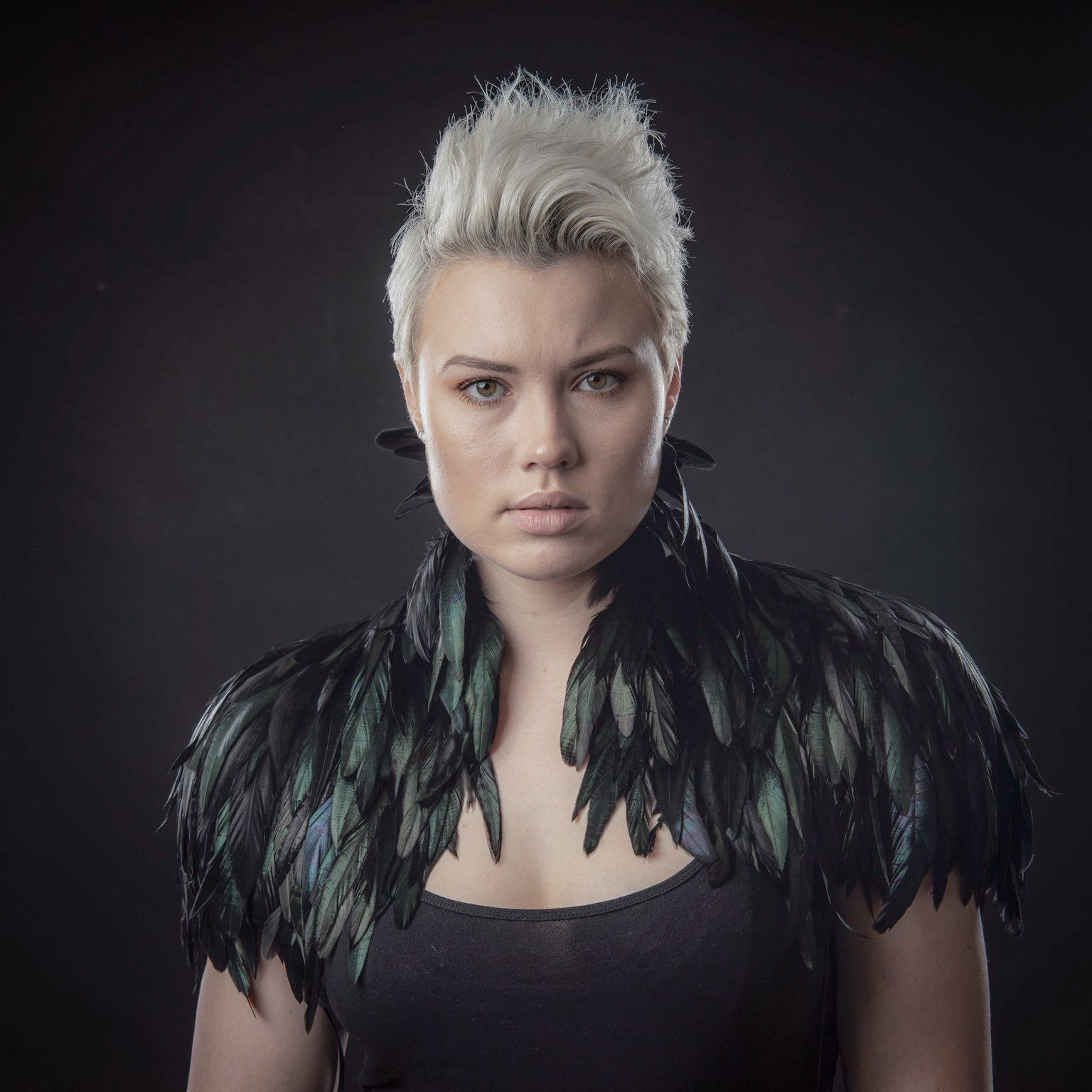 cool woman wearing luxurious black feather shrug