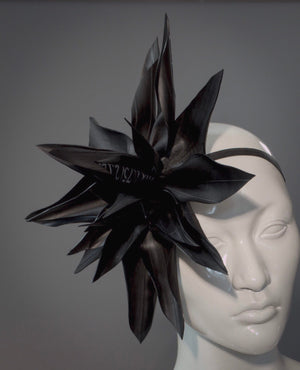 Cyberpunk rubber lotus fascinator made of upcycled bicycle tubes / Eco fashion flower headband