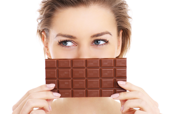 Woman Holding Chocolate Bar - www.chocolateandmoredelights.com