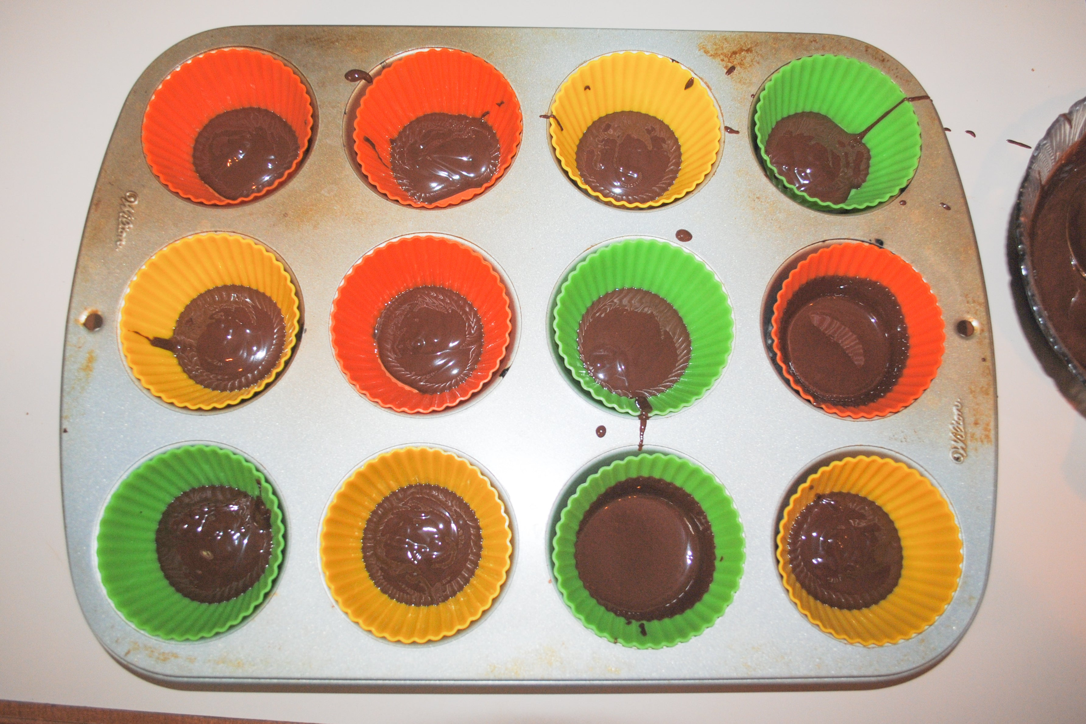 Double Chocolate Peanut Butter Cups - Add 1 tablespoon of melted chocolate to the bottom of each muffin liner