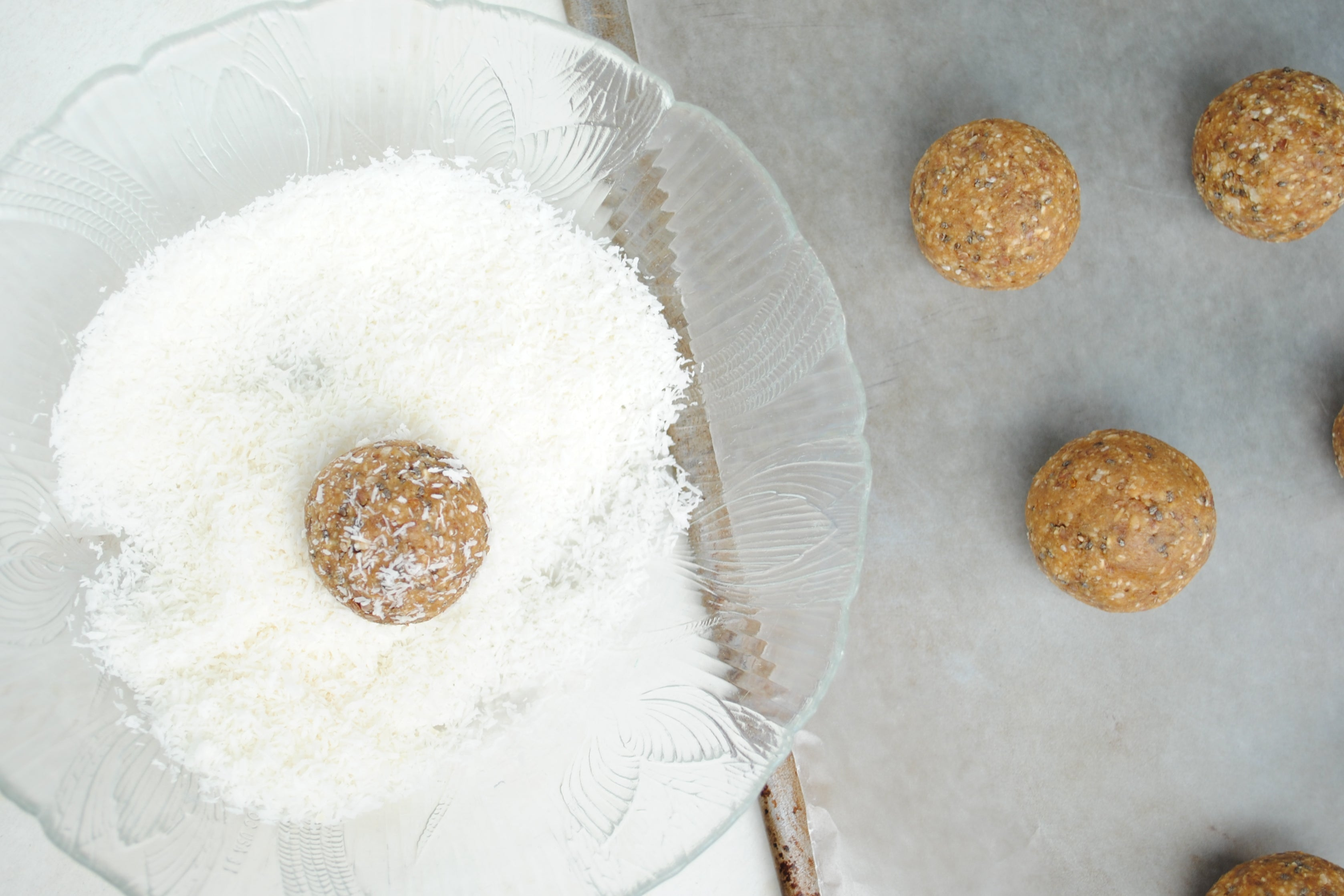 Peanut Butter Coconut Energy Balls - Roll each of the balls in coconut to coat the outside
