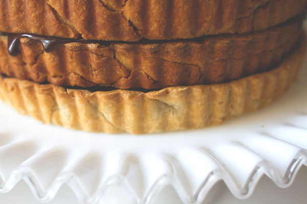 Peanut Butter Chess Stack Pie - Firmly stack one of the remaining tarts on top of the frosted tart