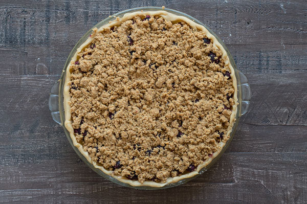 Gluten Free Peanut Butter Streusel Blueberry Pie - Add the peanut butter streusel on top of the pie filling