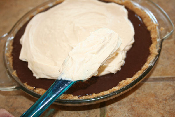 Peanut Butter Chocolate Cream Pie - Spread the whipped cream on top of the pie