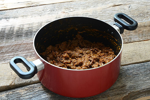 Peanut Butter Carnitas - return it to the pot with the 1/2 cup of sauce
