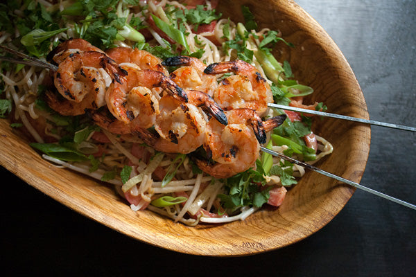 Vermicelli Salad with Grilled Shrimp & Ginger-Peanut Butter Dressing - divide the noodle salad between four serving bowls, and top each one with a skewer of grilled shrimp